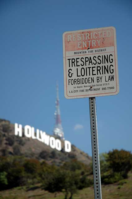 Hollywood sign with warning signs...