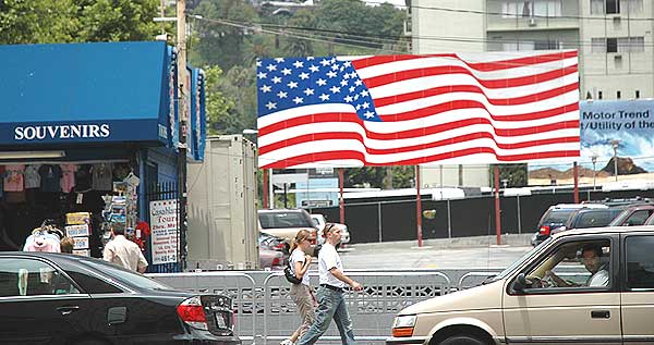 Flag and tourists on Hollywood Boulevard