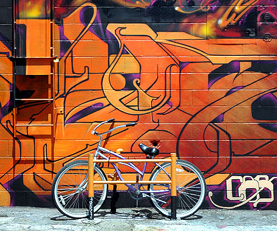 A bicycle in alley  behind a building on Melrose