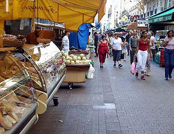 Paris street market - cheese stalls -