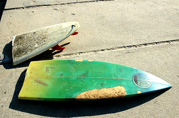 A shattered California dream?  Broken surfboard.
