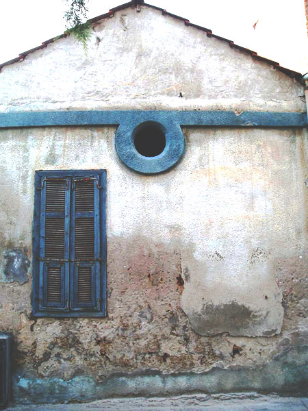 Lovers behind closed shutters at siesta time -