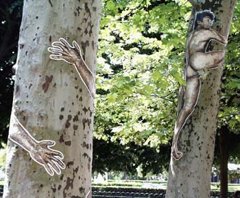 Paris park with surreal men in trees,,,,